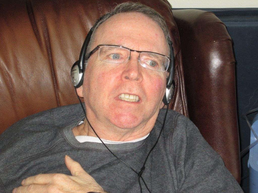 A picture of Ken enjoying personalized music.
