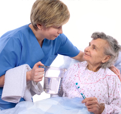 Image of caregiver helping an elderly woman