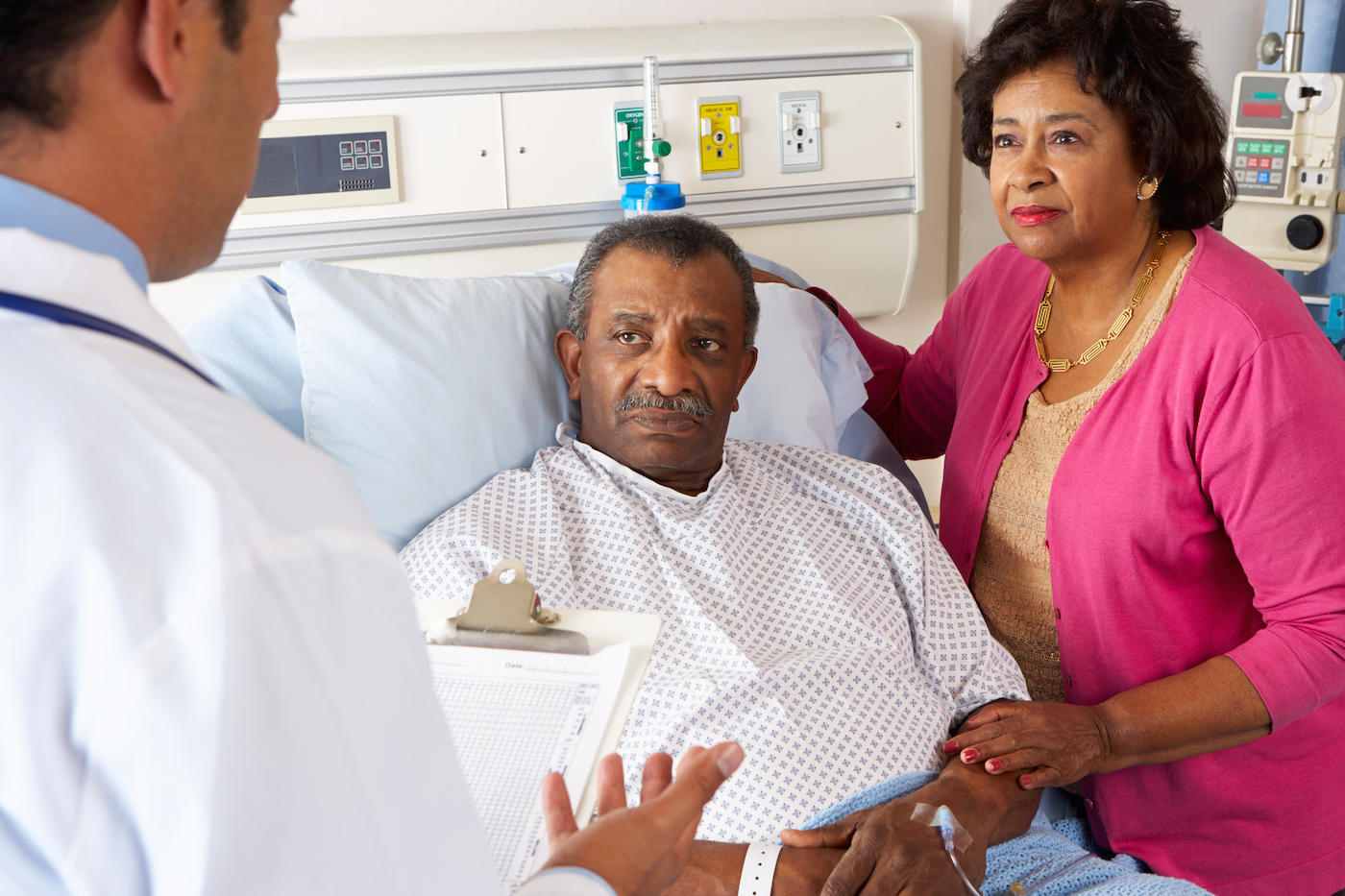 Doctor consults with couple in hospital room