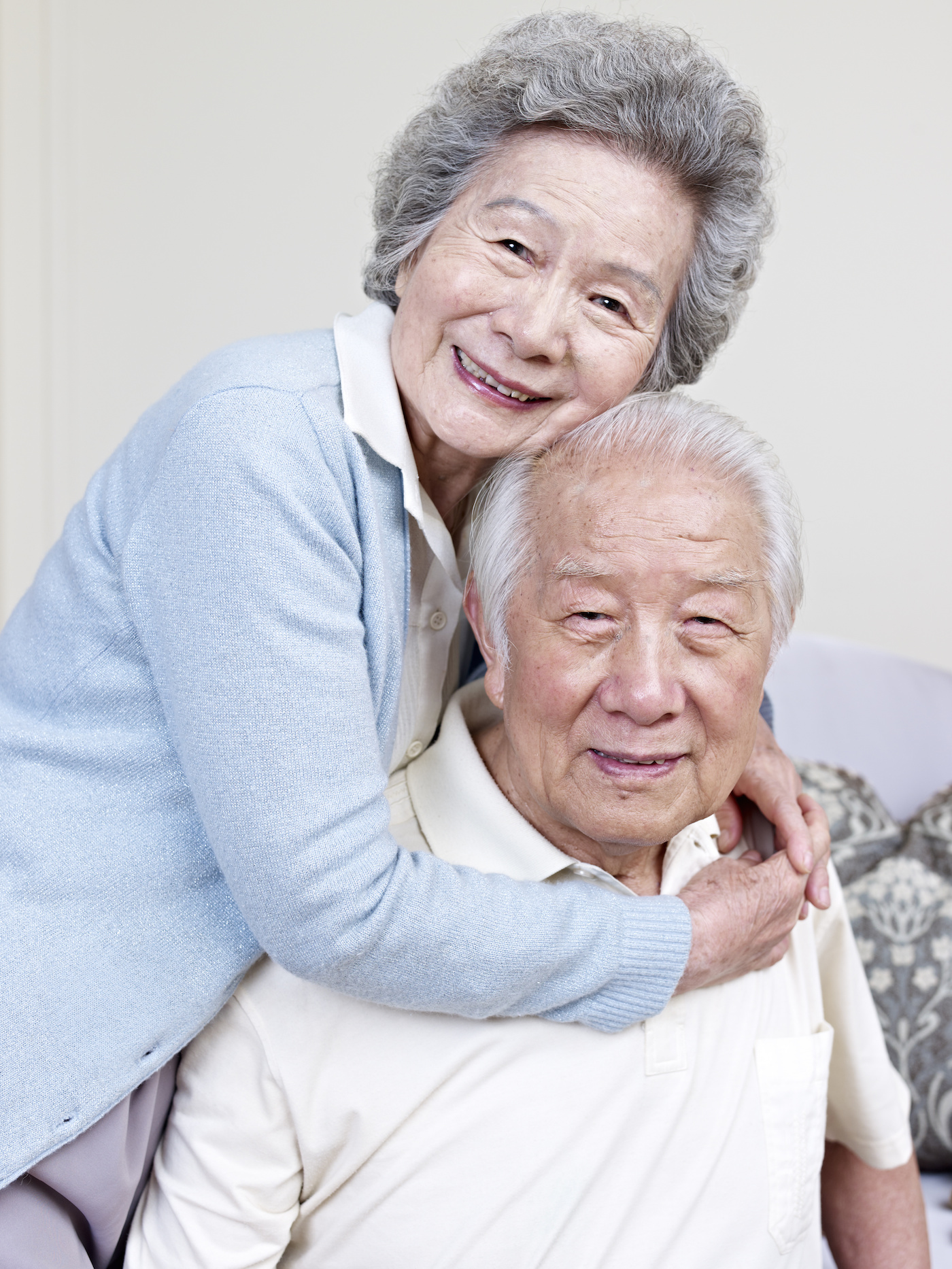 Elderly Asian couple smiling together