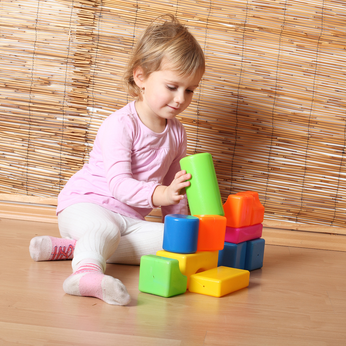 Toddler plays with blocks
