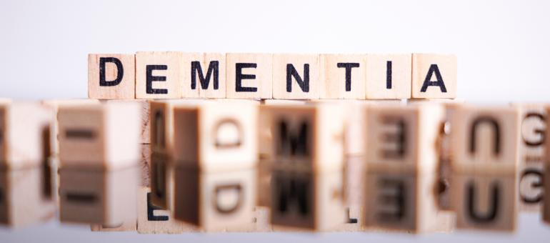 Wooden blocks spelling Dementia on top of blurred blocks