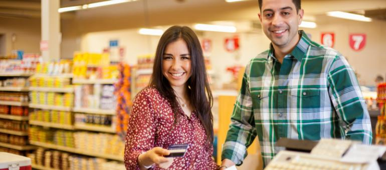 A couple purchases groceries with a bank card