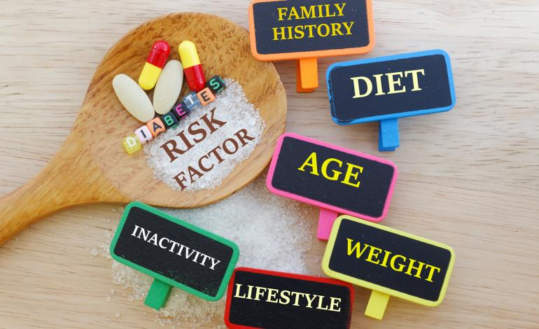 Diabetes risk factor multi-colored markers with a wooden spoon and pills