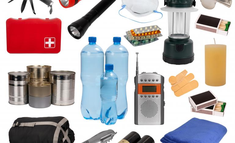 Variety of emergency supplies such as flashlight, batteries, blanket, water, etc