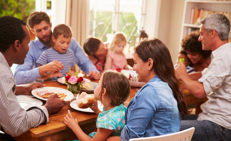 Multi-ethnic family eating a meal together