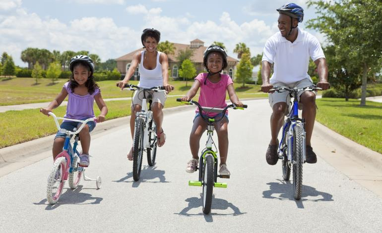 Active family biking on the road