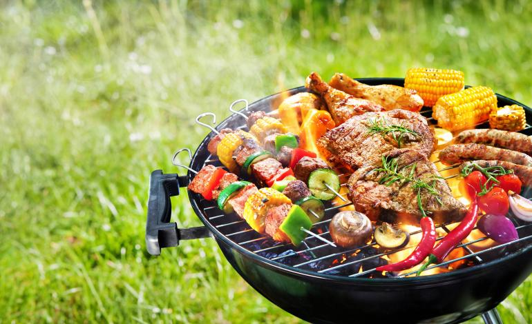 Kabobs, meat, veggies on a smoking grill
