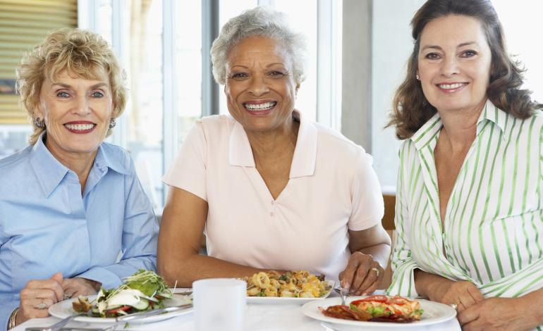 Three women lunch together