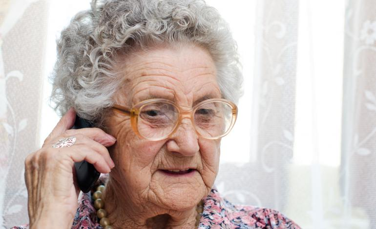 Elderly woman using phone