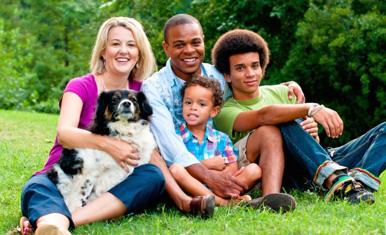 Family with their dog at a park