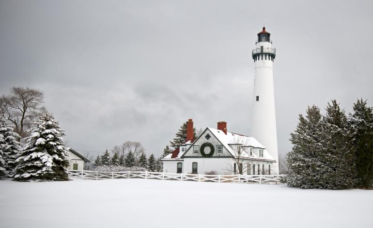 Winter landscape showing a lighthouse