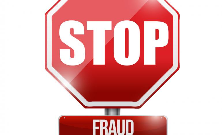 Stop sign symbol with the word 'fraud'