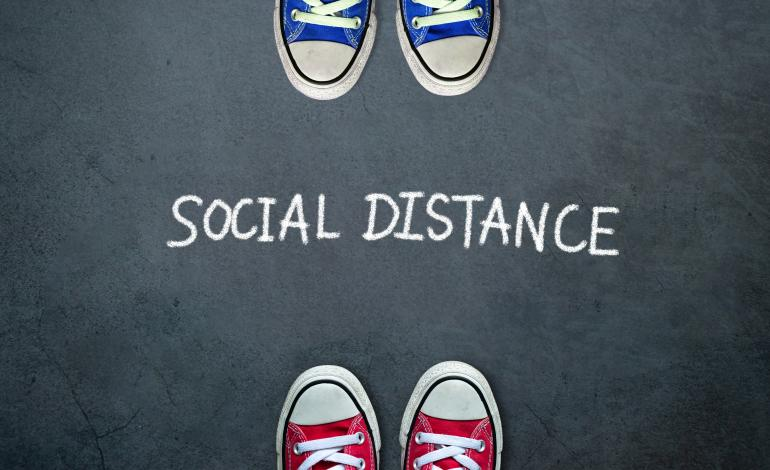 Social Distance between the toes of red sneakers and blue sneakers