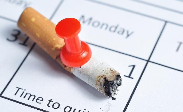 Cigarette tacked to calendar