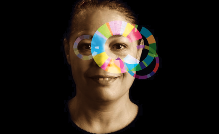 Woman with rainbow circles representing Trauma Informed Care