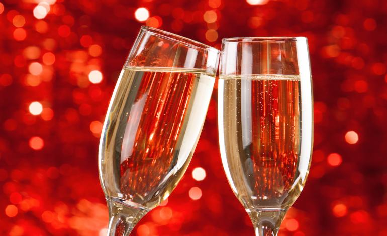 Toasting the New Year with two glasses of champagne