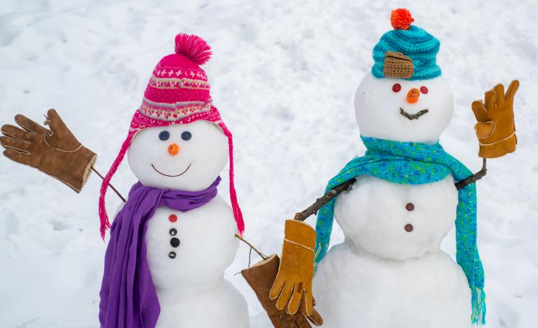 Two snowmen with hats, gloves and scarves