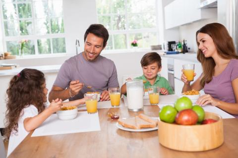 Family eating breakfast in their kitchen