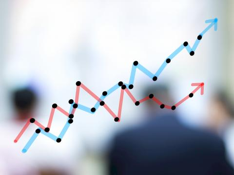 Line graph representing data trends with blurred people in background