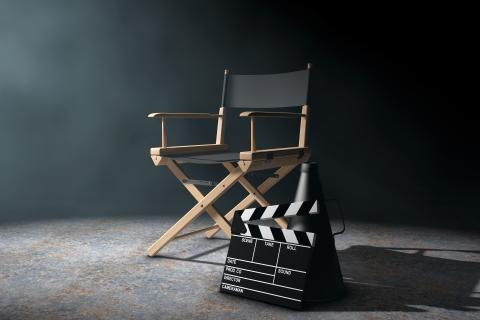 A clapboard leans against a director's chair.