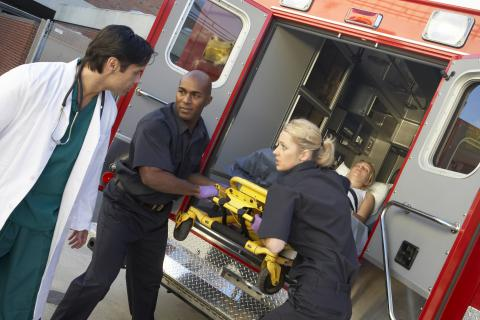 Image of EMS staff delivering a patient to a hospital
