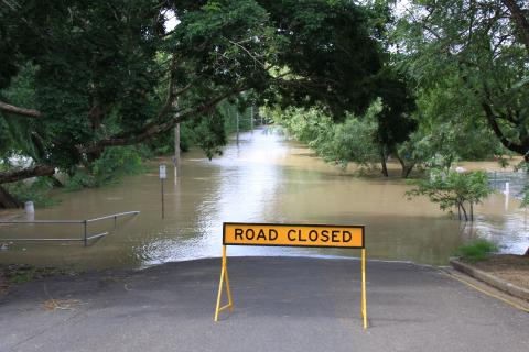 A sign, road closed, set on flooded road