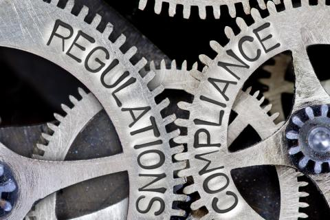 Interlocking gears with imprinted words: Regulations, Compliance