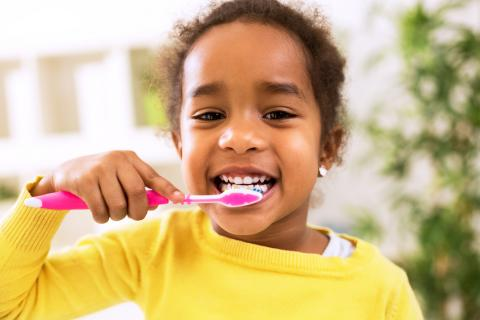 Young child brushing teeth