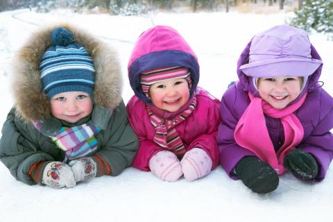 Group of children playing in the snow