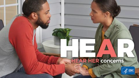 Two adults holding hands with: Hear Her concerns