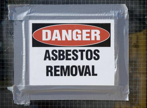 Danger sign indicating asbestos removal