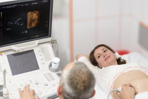 Pregnant woman undergoing ultrasound