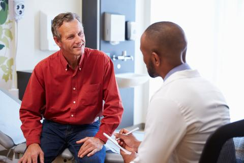 Male patient talking to doctor