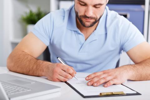 Man signing a document