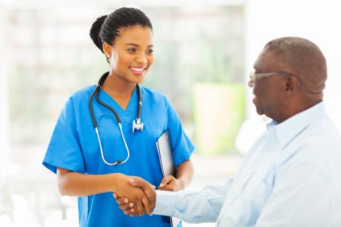 Nurse shaking hands with a male patient