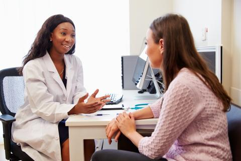 Physician consults with her patient