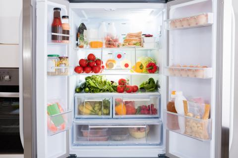 French door refridgerator full of fruits and vegetables