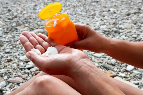 Sunscreen in the palm of a hand