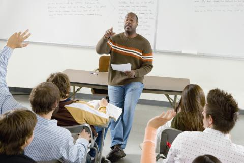 A teacher giving a lecture in the classroom