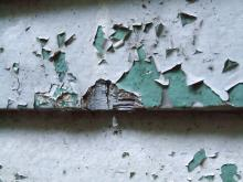 Close-up of flaking lead paint