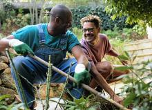 Image of a gay couple performing garden work