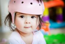 Toddler wearing her bike helmet