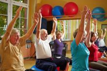 People sitting on physio balls in fitness class