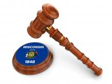 State of Wisconsin symbol on a sound block with a gavel hover over.