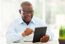 Man using tablet device