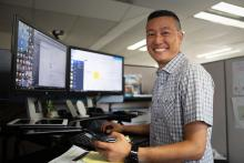 James Kim standing at workstation