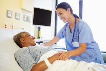 Nurse talking with patient in hospital room