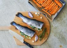 Rainbow Trout stuffed with herbs on cutting board