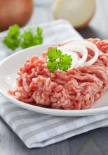 Raw meat with garnish in white dish